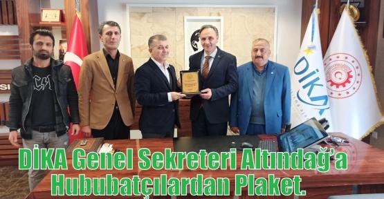 DİKA Genel Sekreteri Altındağ'a Hububatçılardan Plaket.