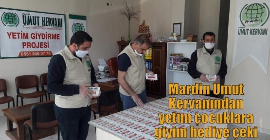 Mardin Umut Kervanından yetim çocuklara giyim hediye çeki